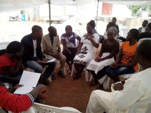 Youth discussing the need to re-plant more trees