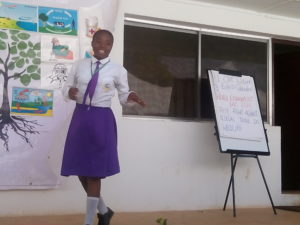 A student presenting on the medical importance of trees