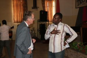 Peter Harris discussing with a student at JETS: an interest ignited